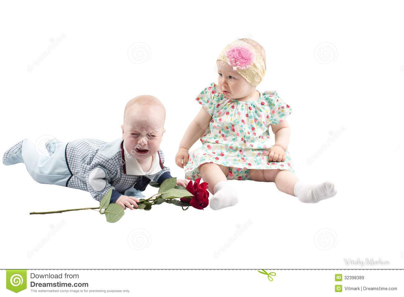 baby boy presents red rose flower to cute child isolated on