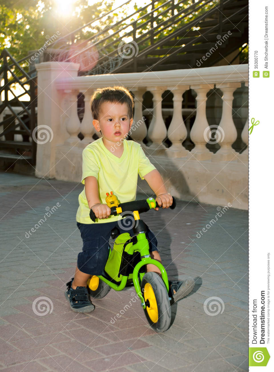 Kids Balance Bike >> Baby Boy Riding On His First Bike Without Pedals Stock Photo - Image: 35300770