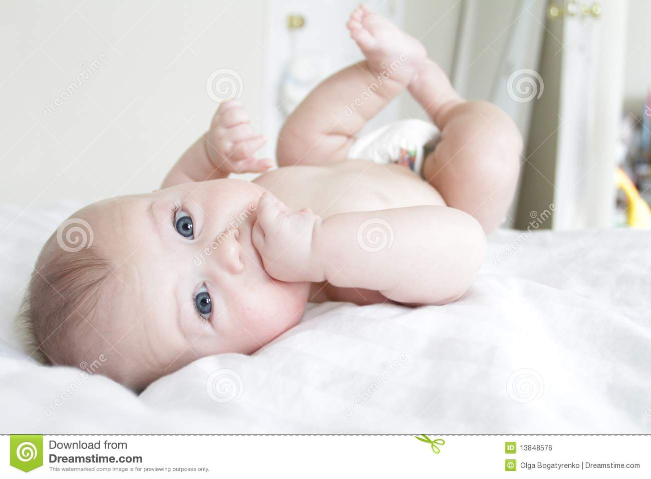 Download Baby Boy Rolling On Bed, Playing Stock Photo   Image Of Blue, Home