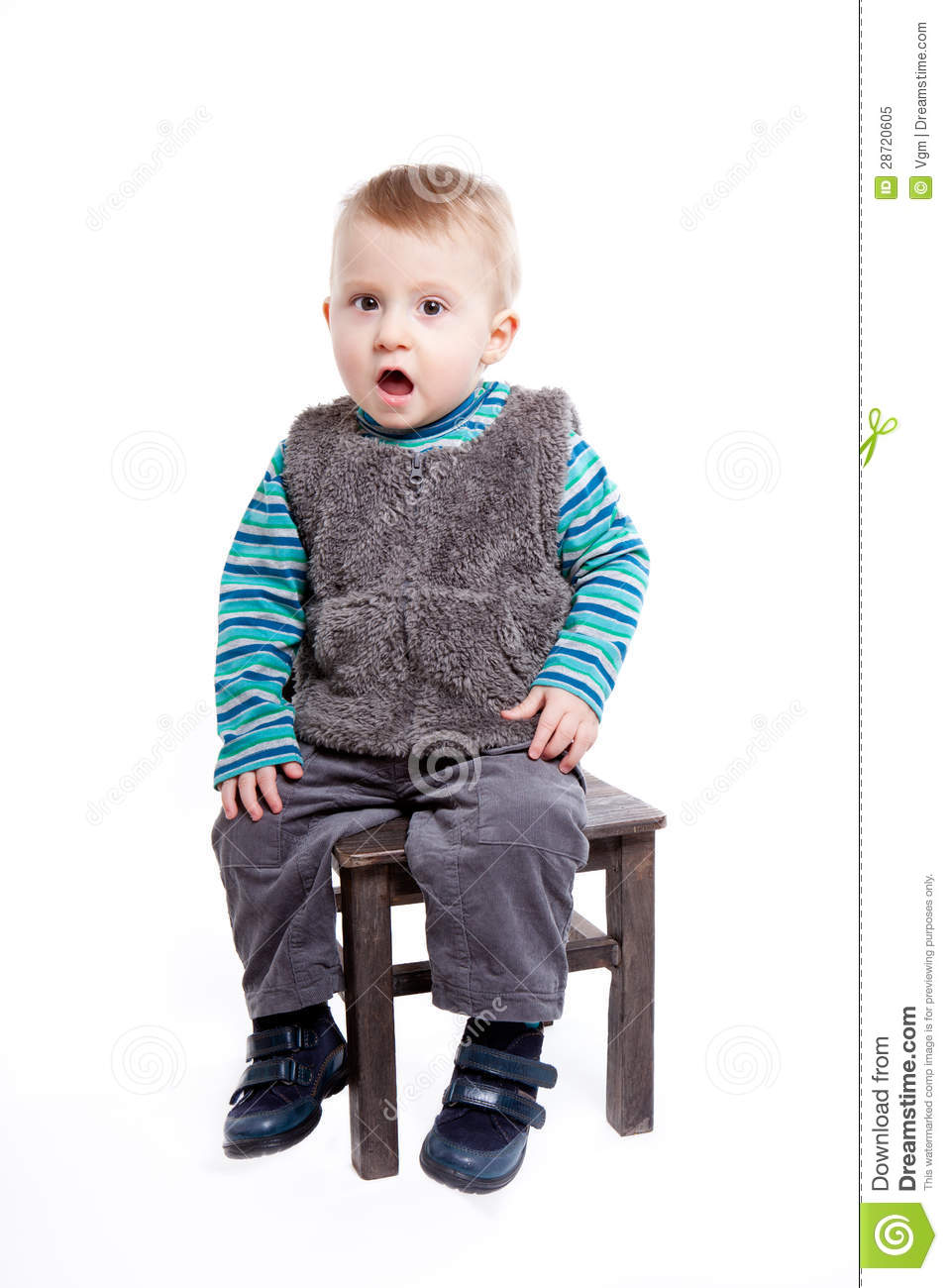 Baby boy sitting on a chair royalty free stock photo for Toddler sitting chair