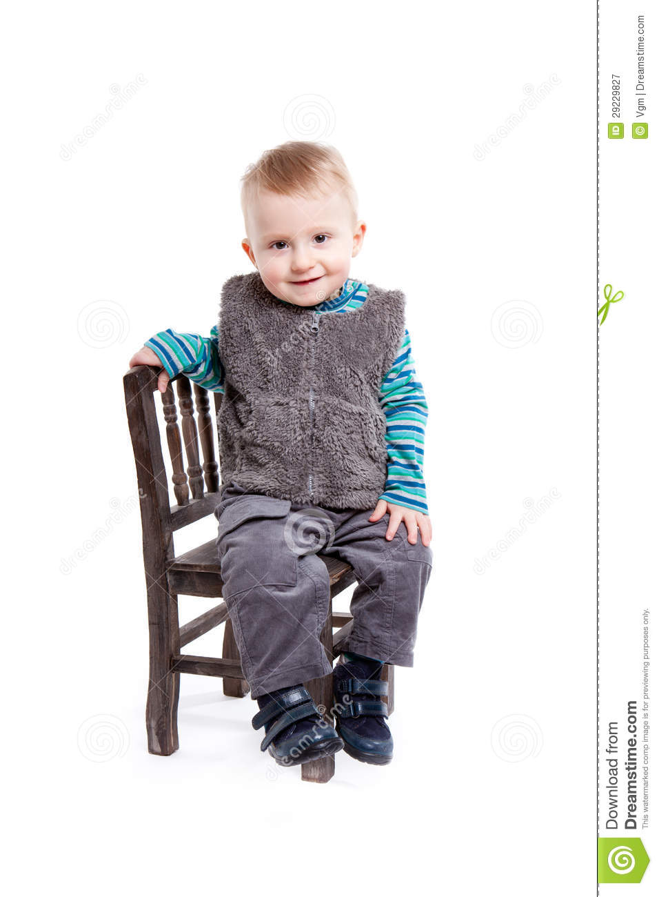 Baby Boy Sitting On A Chair Royalty Free Stock Photography