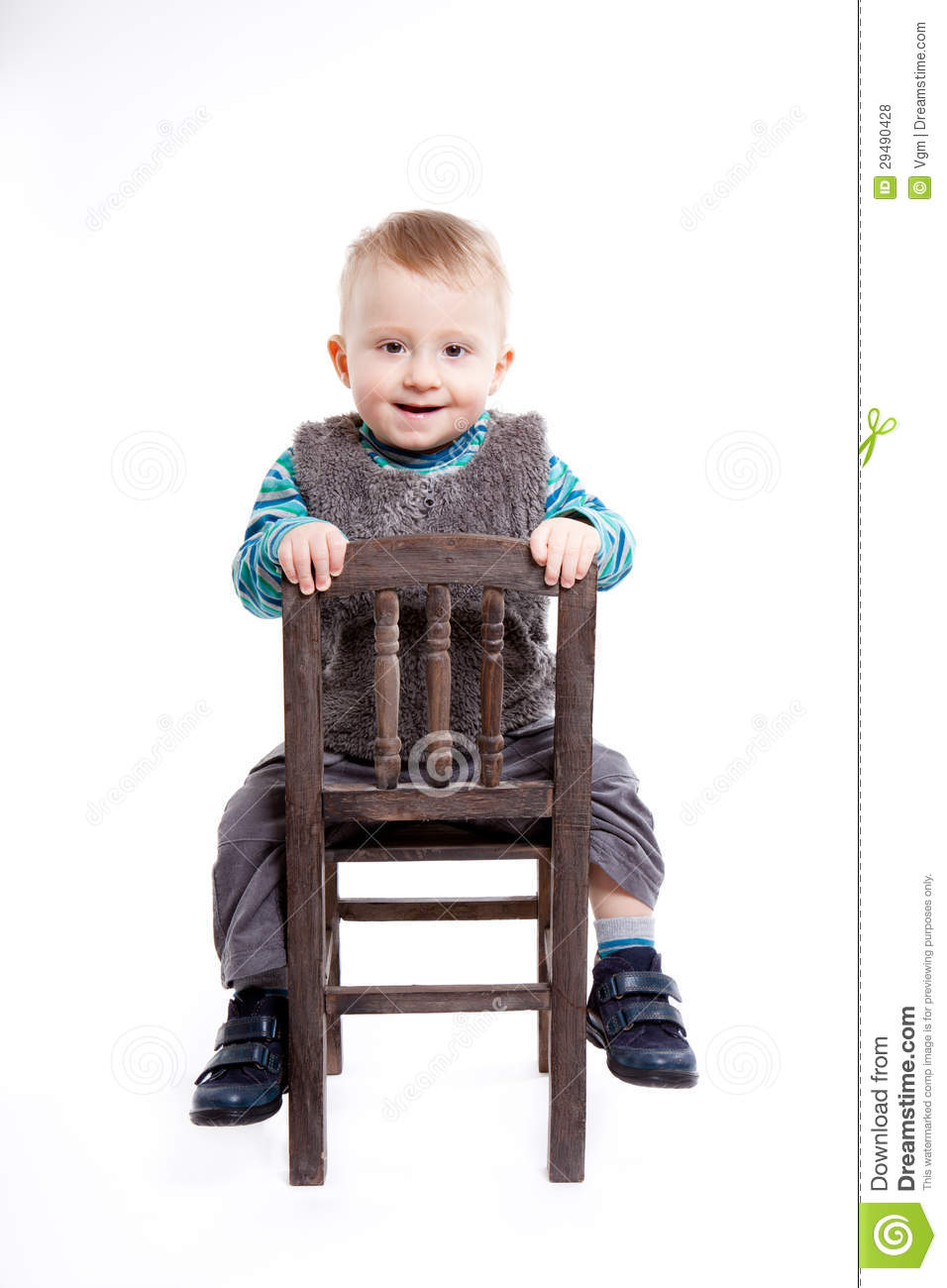 Baby boy sitting on a chair royalty free stock photos for Toddler sitting chair