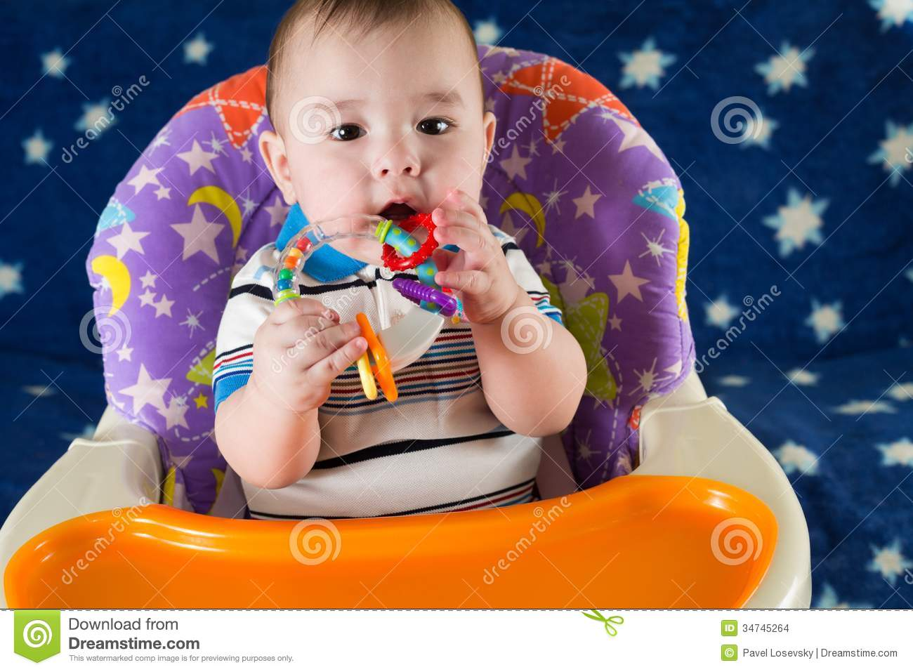 Download Baby Boy Is Sitting At The Childrens Table Stock Photo - Image of cheerful, people: 34745264