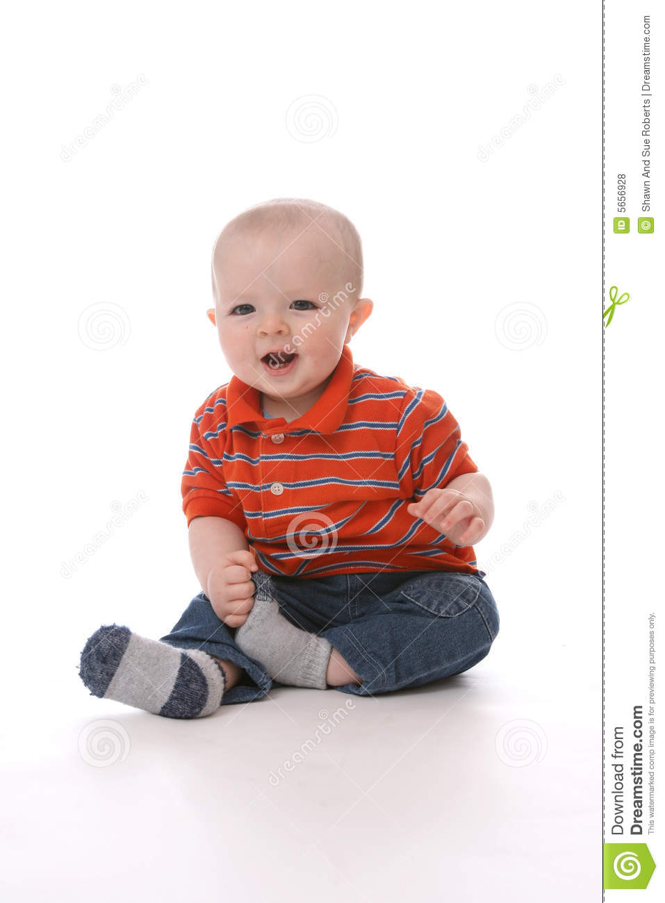 7925cd2fc Baby Boy Sitting And Pulling His Sock Off Stock Photo - Image of ...