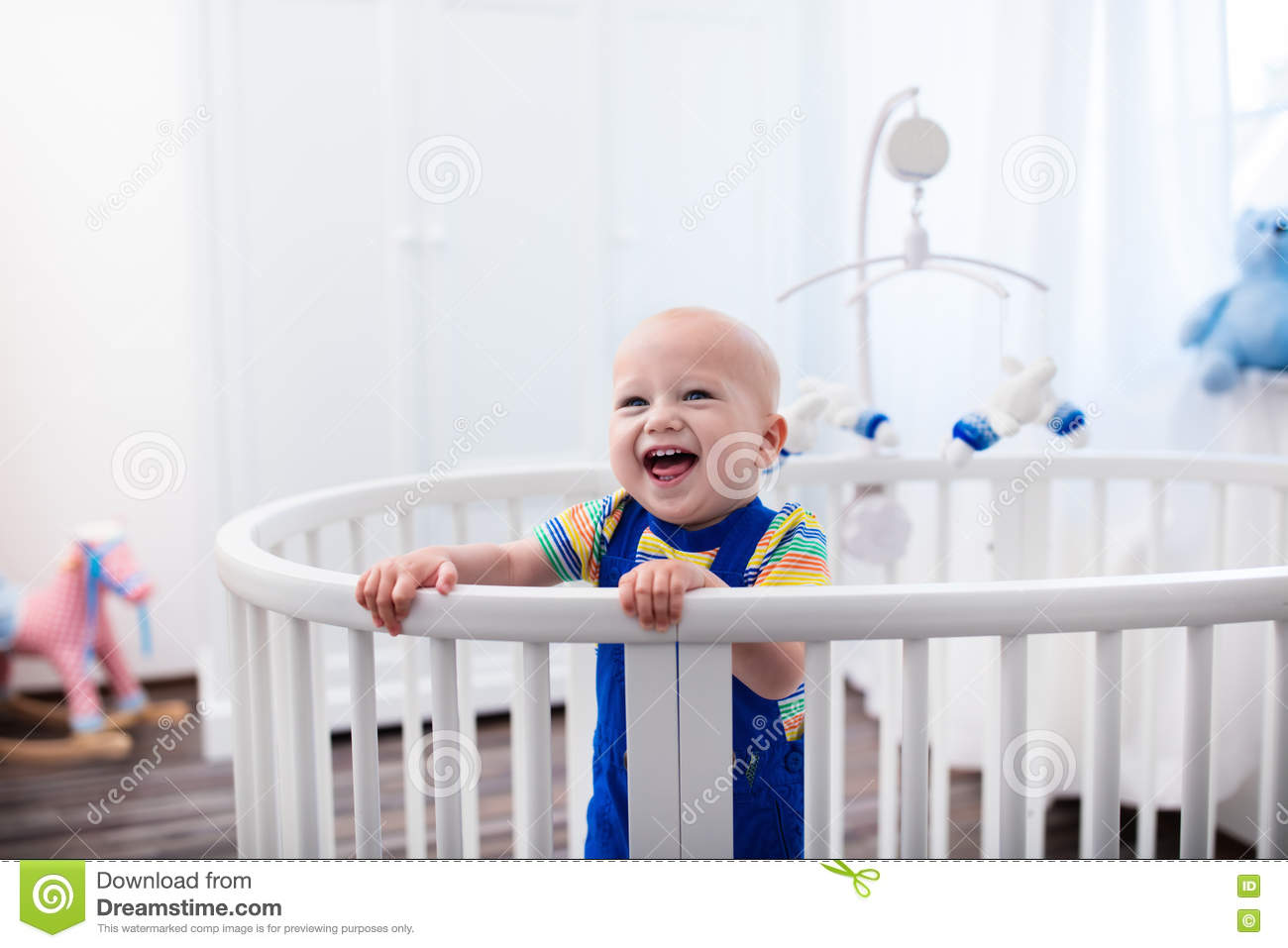 bbf0a4564f0f Baby boy standing in bed stock image. Image of girl