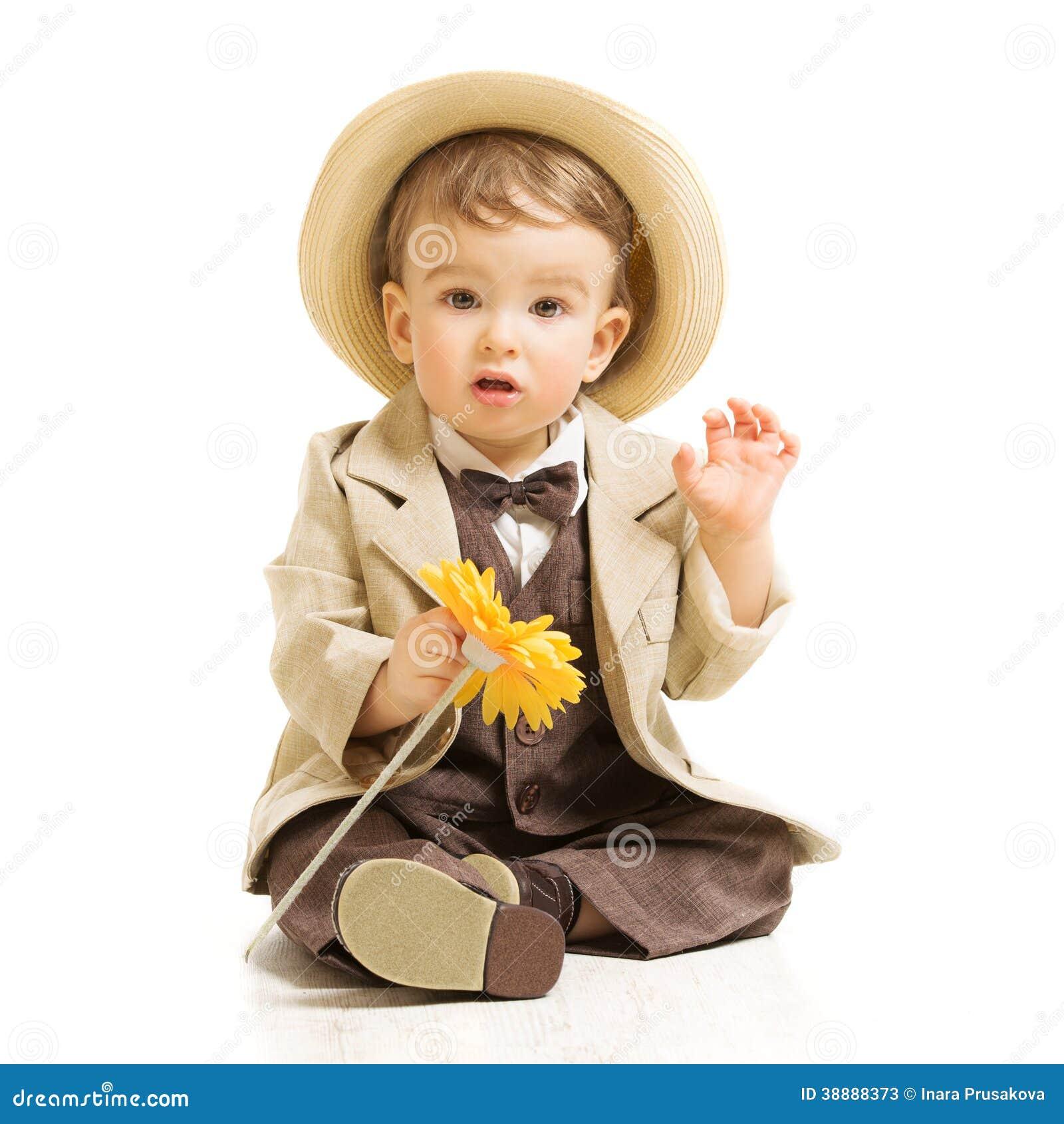 Baby boy in suit with flower. Vintage children