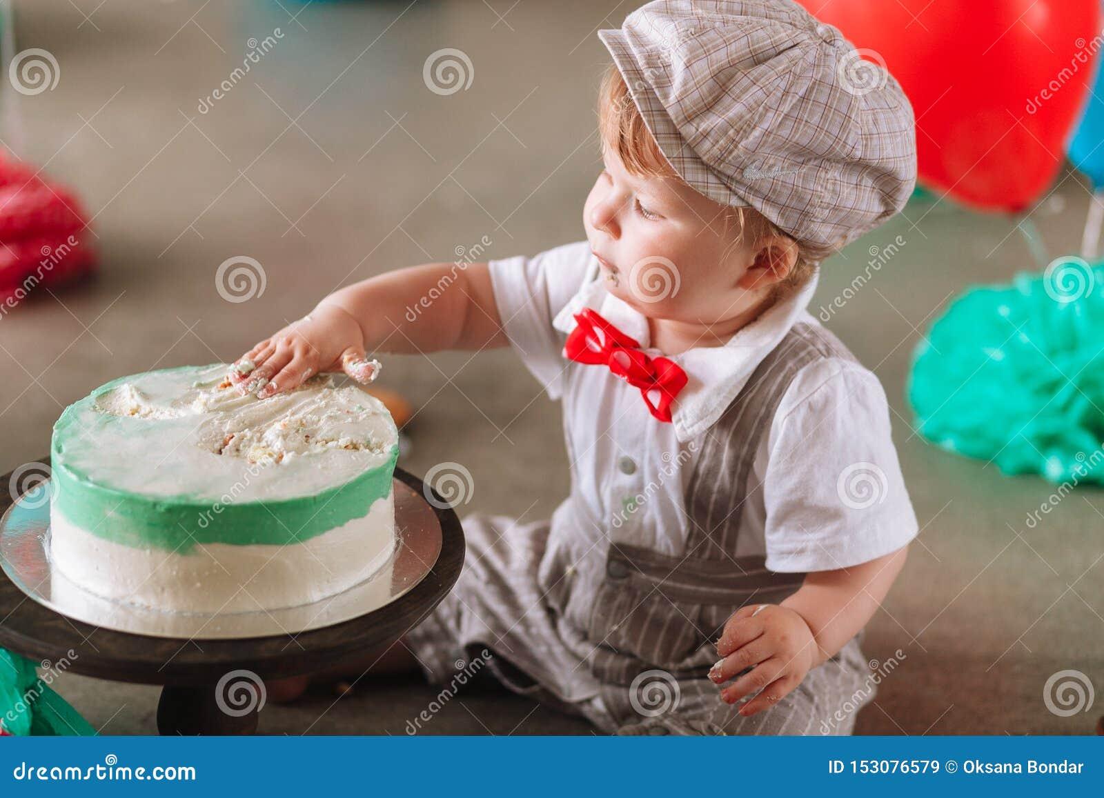 Pleasant Baby Boy Touching His First Birthday Cake Making Messy Cakesmash Funny Birthday Cards Online Amentibdeldamsfinfo