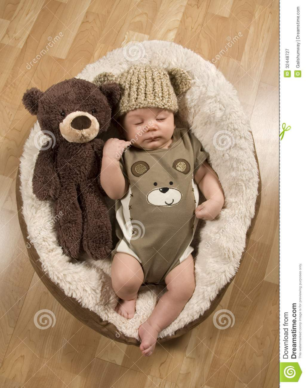 8350e9ad06c Baby boy 7 weeks old asleep on his back next to a teddy bear wearing a  teddy bear hat and romper.