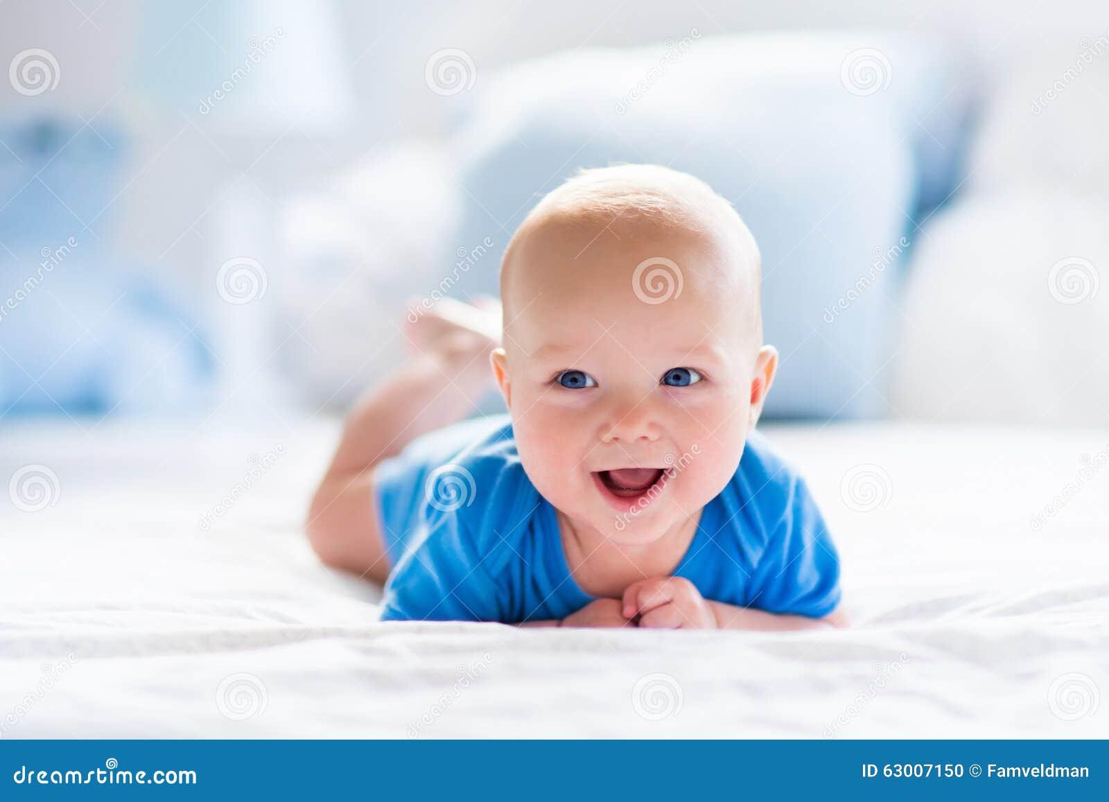 Baby Boy In White Sunny Bedroom Stock Photo Image 63007150