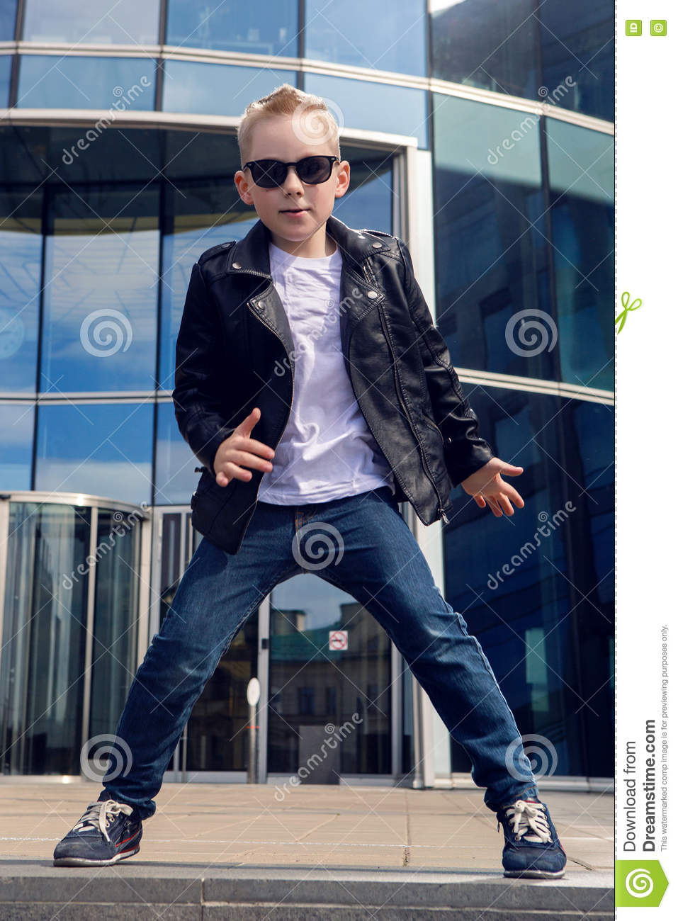 4f589aab1533 Baby Boy 7 - 8 Years In A Black Leather Jacket Dancing Stock Photo ...