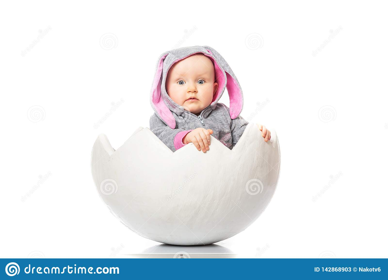 Kinder Egg Chair.Baby In A Bunny Costume In Egg On White Background Kinder