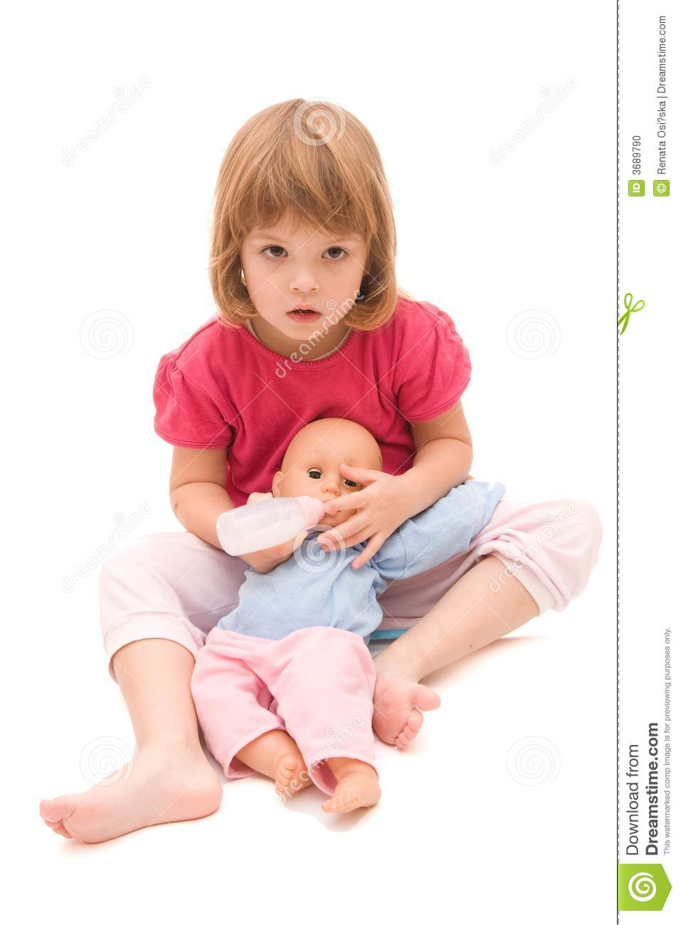 Little girl taking care of her baby doll