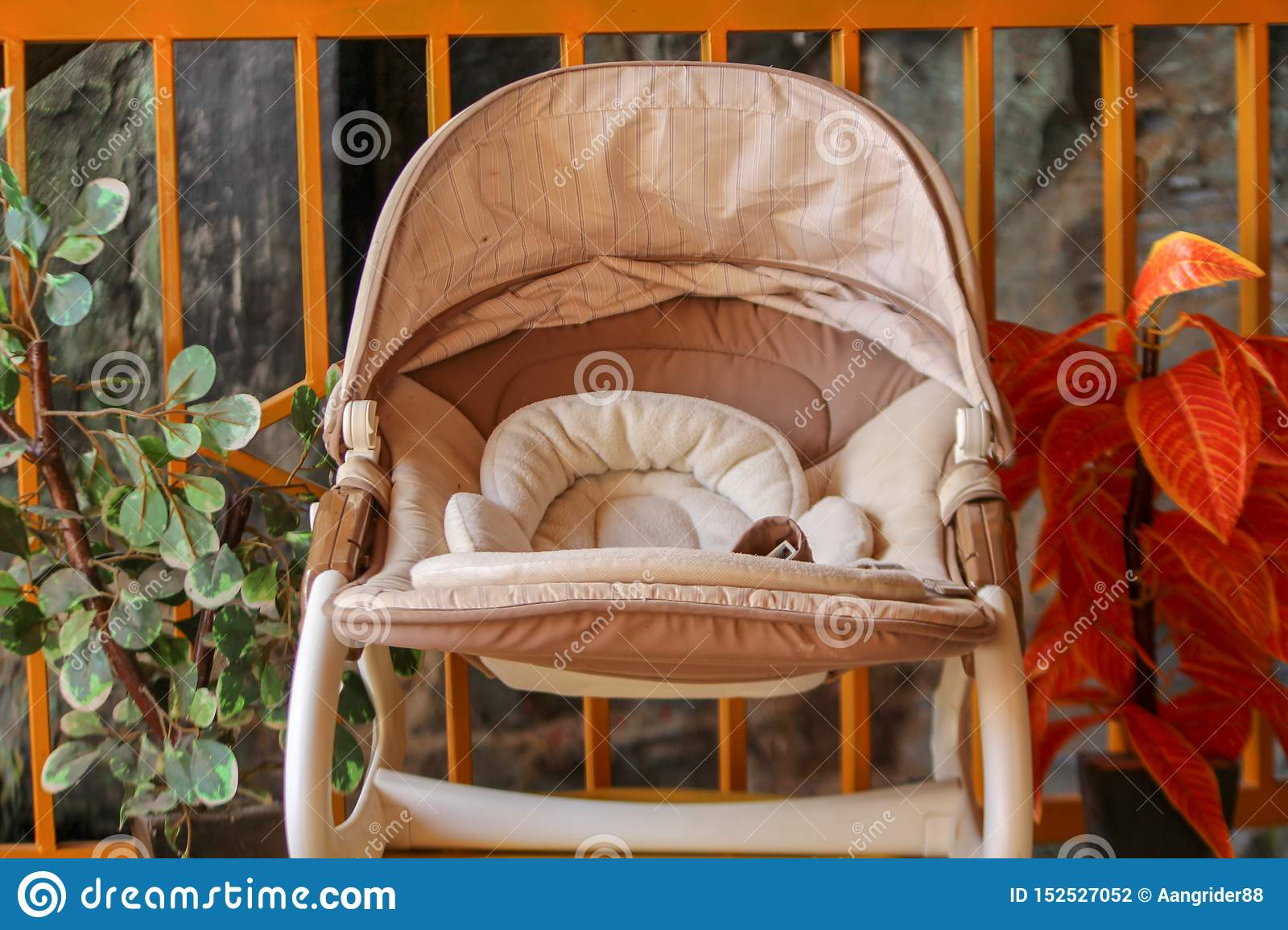 Baby carriage with a flower background in the garden