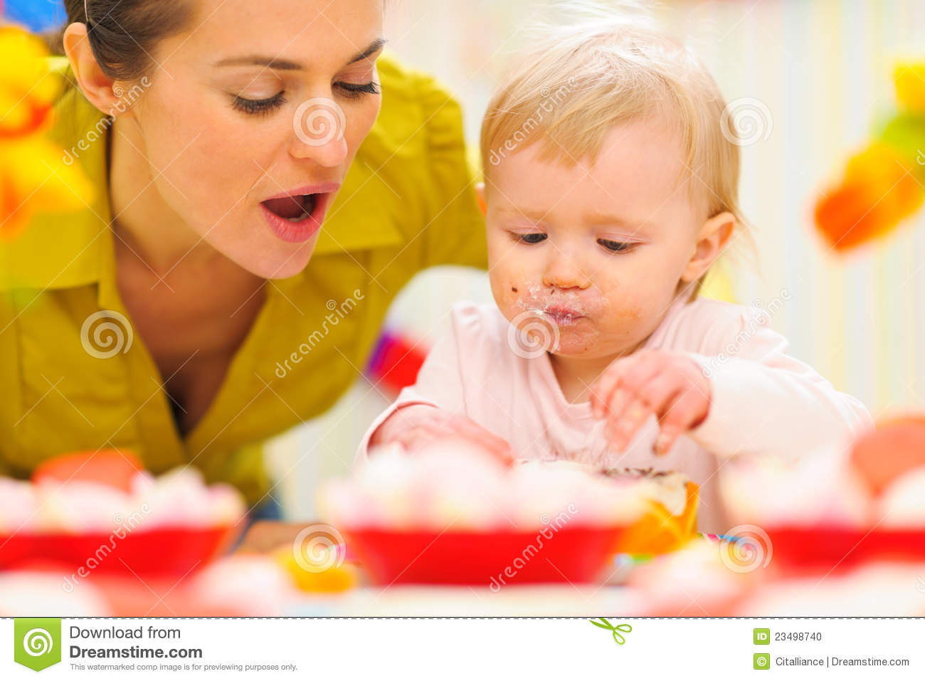 Baby Celebrating First Birthday With Mom Stock Photo