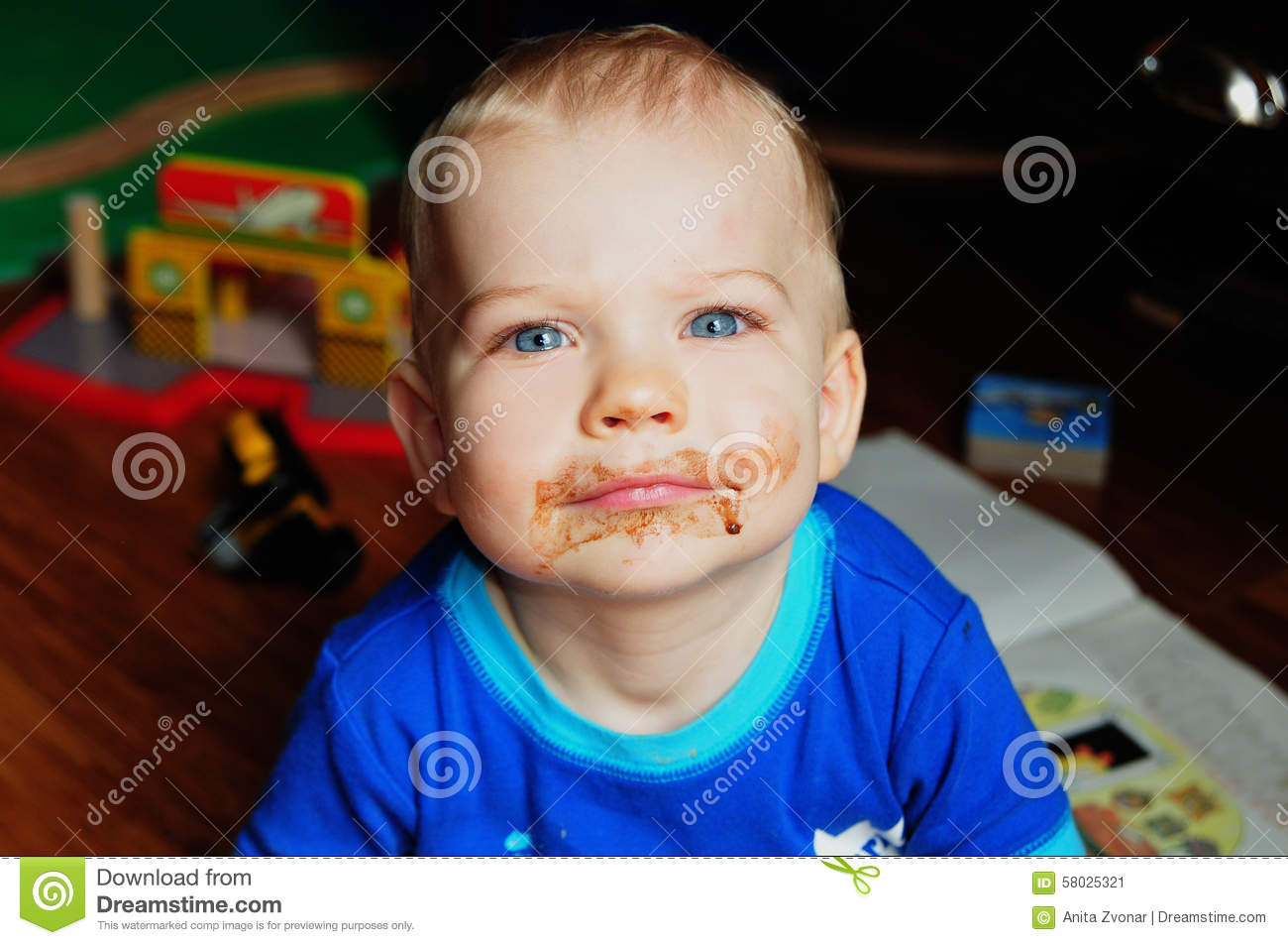 Baby With Chocolate On Face Stock Photo - Image: 58025321