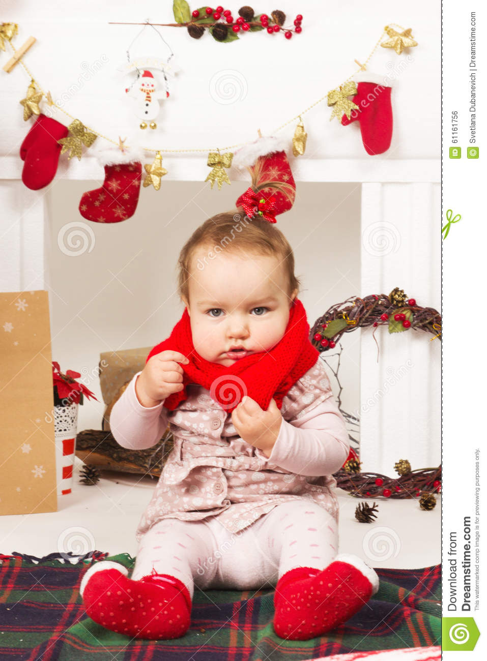 Baby in christmas decorations stock photo image 61161756 for Baby christmas tree decoration