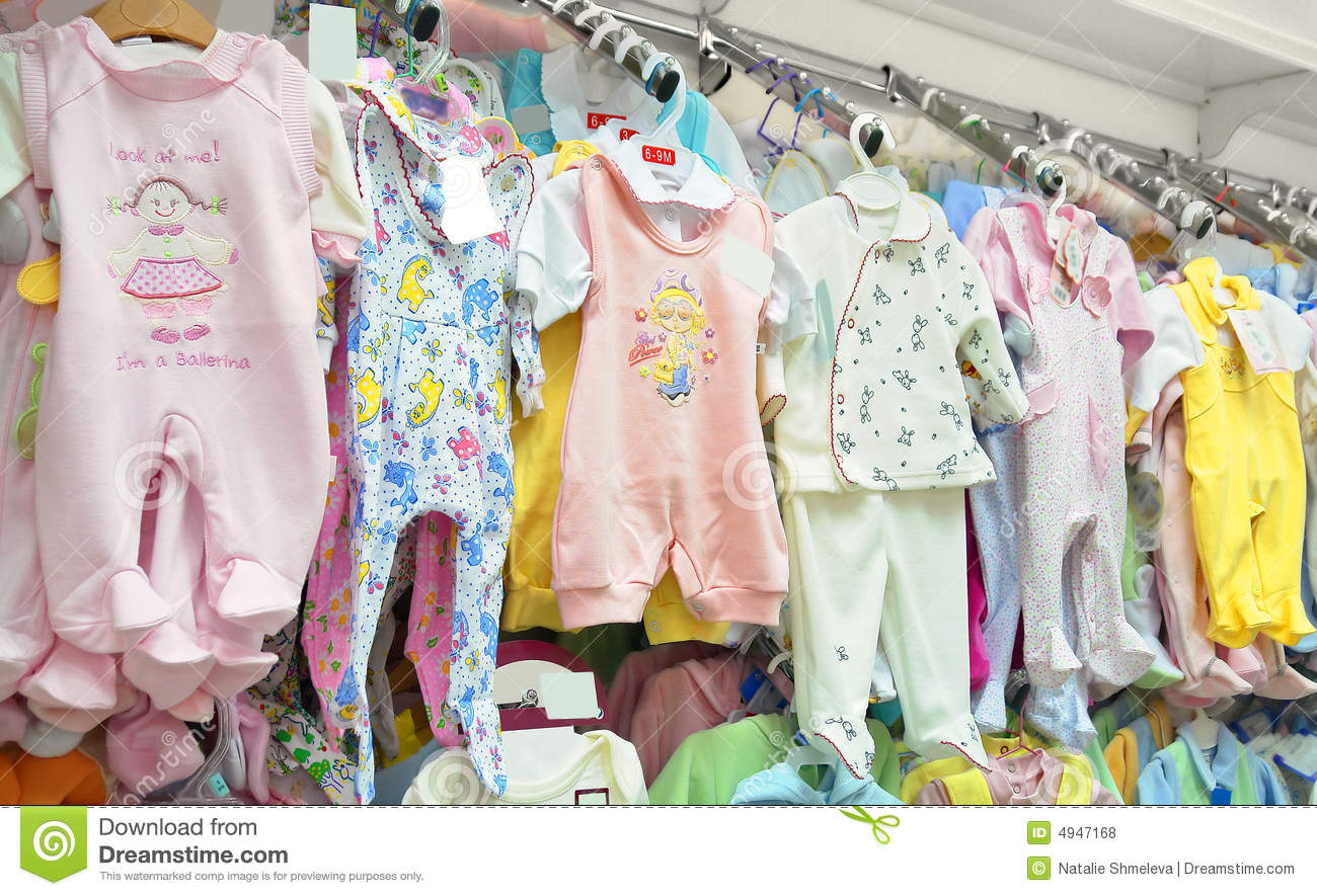 baby clothes stock photo image of clothing indoors sale 4947168. Black Bedroom Furniture Sets. Home Design Ideas