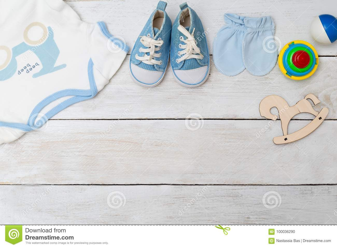 Baby Clothes And Baby Shoes For Boy On Wooden Background ...