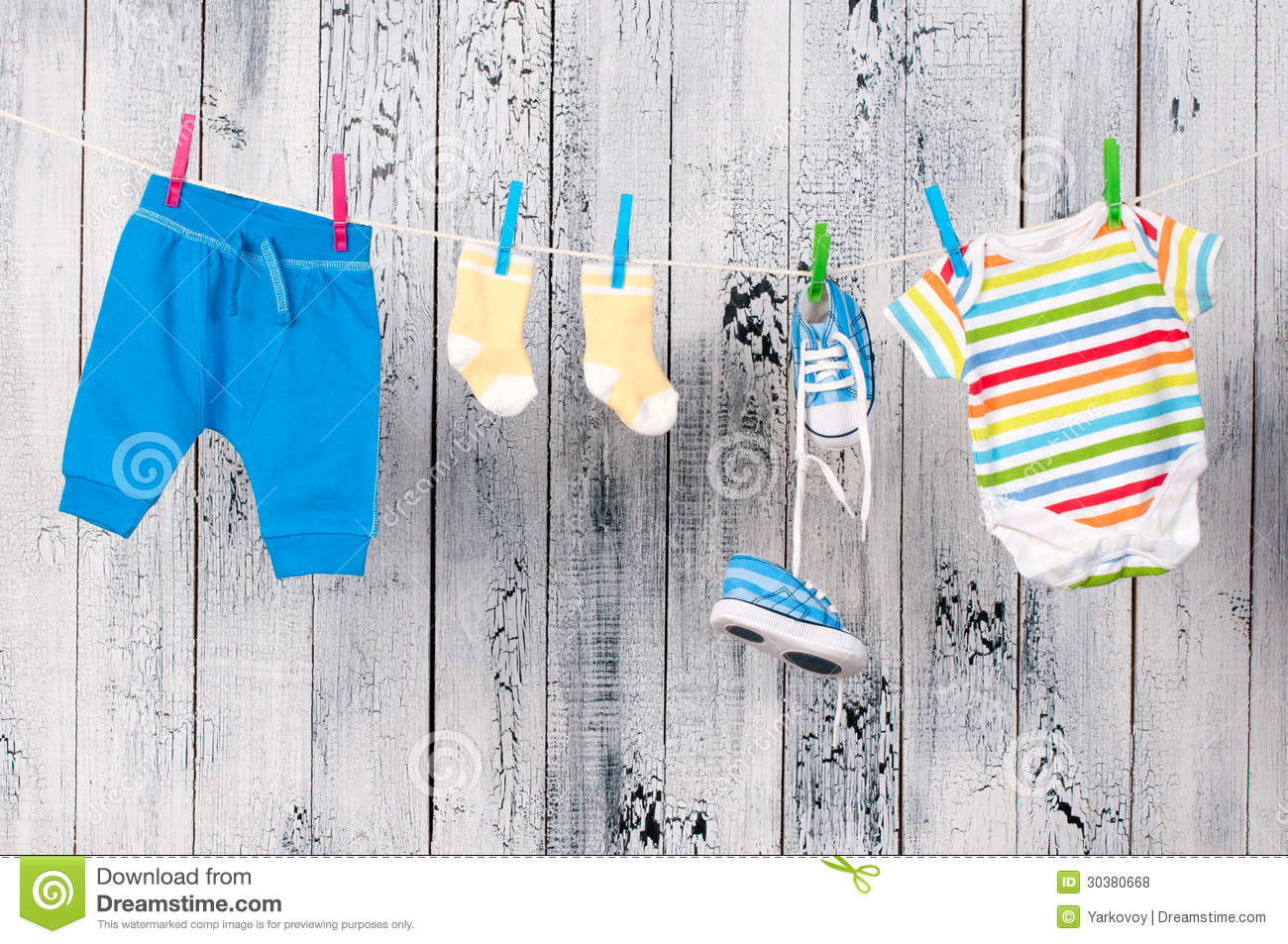 Baby Clothes Hanging On The Clothesline Royalty Free