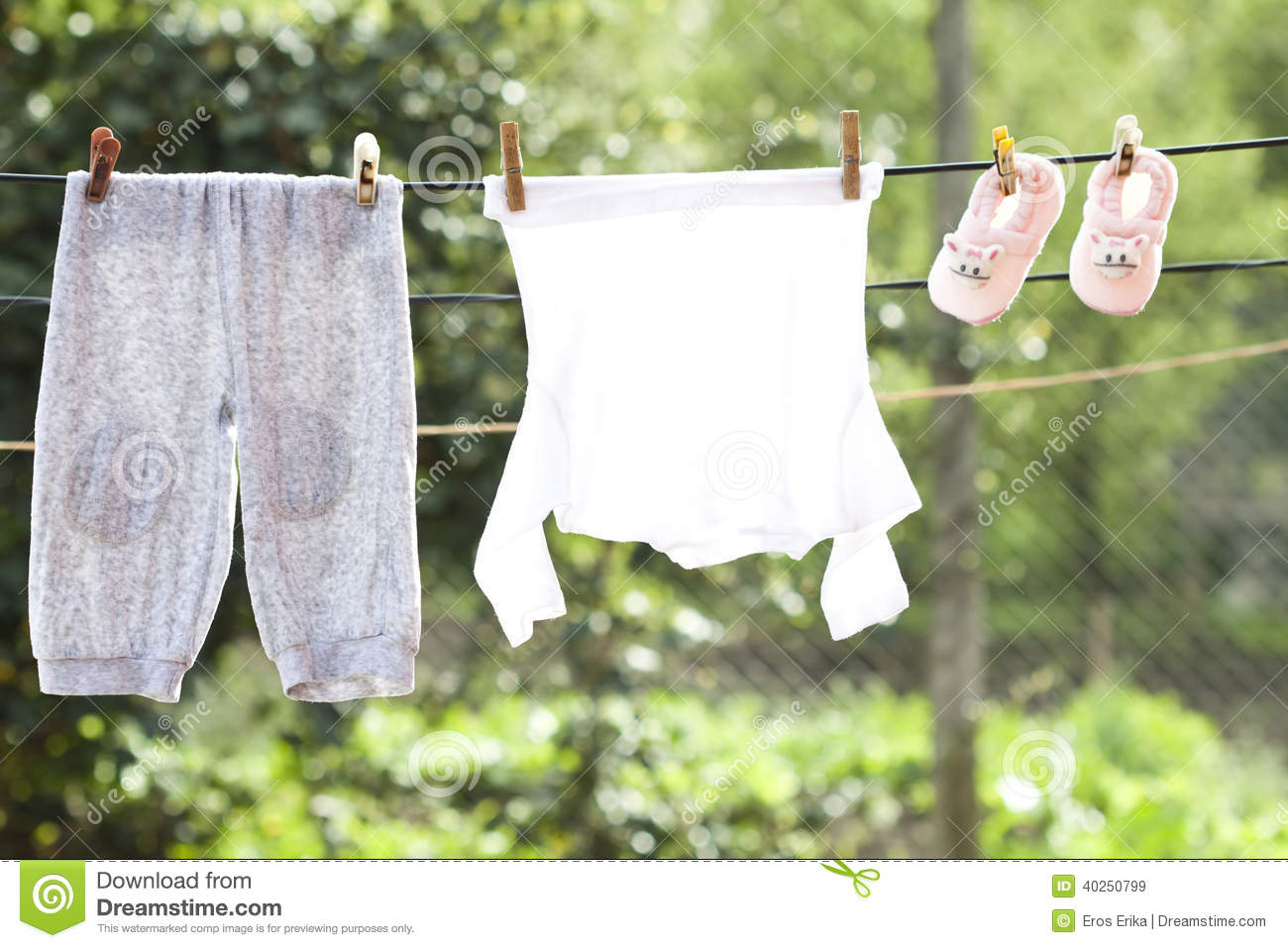 Baby clothes hanging on the clothesline stock image image 40250799