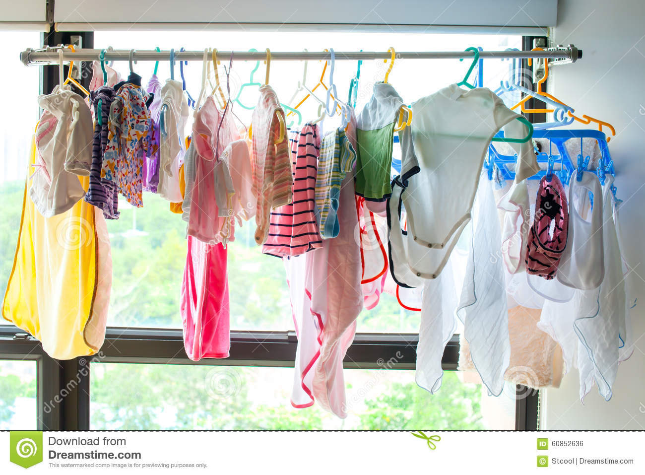 Baby clothes hangs on stock photo Image of clothes born