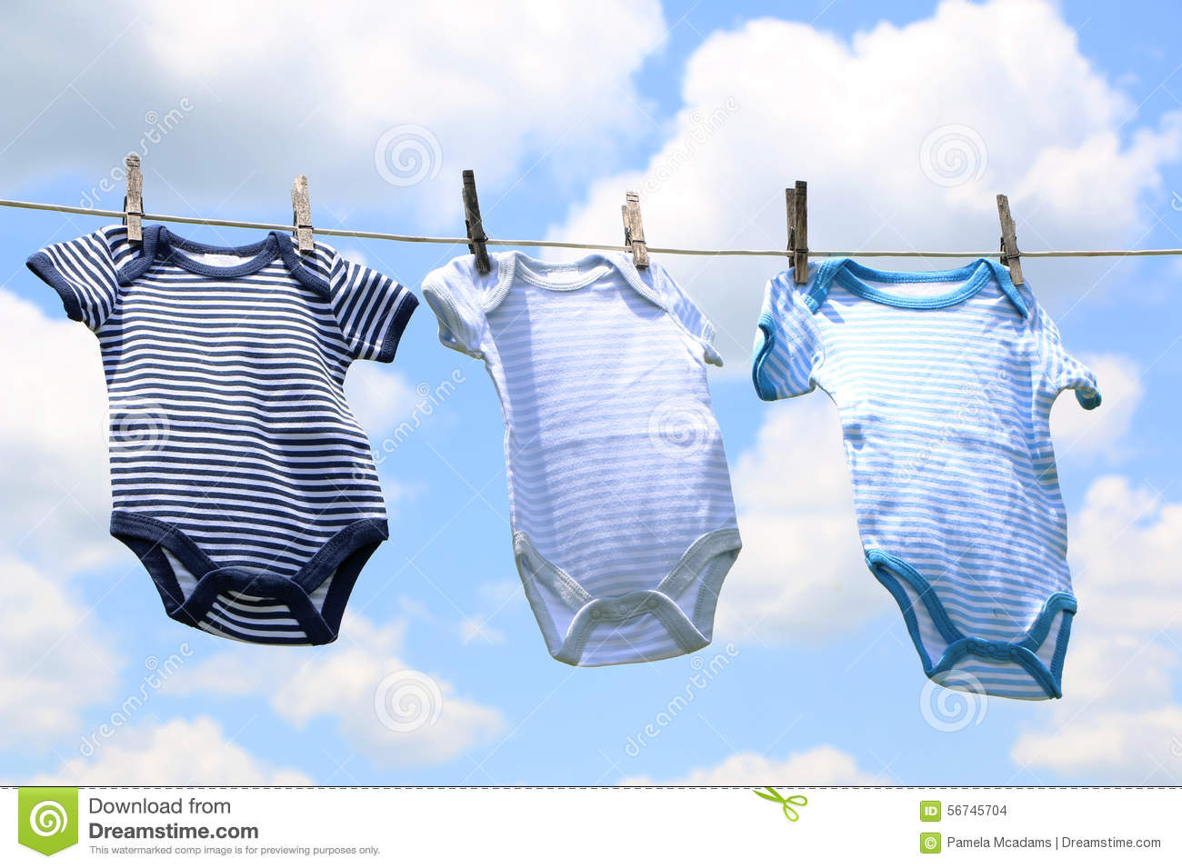 Baby Clothes on a Line stock photo. Image of blue, green - 8