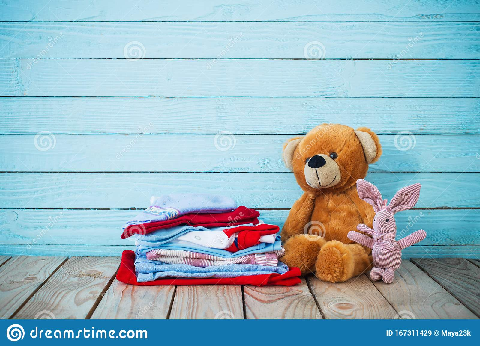 Baby Clothes And Toy Bear On Wooden Background Stock Image ...