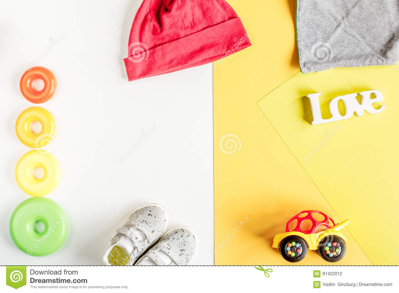 67fc54f8c66a Baby Clothes And Toys On White Background Top View Mock Up Stock ...