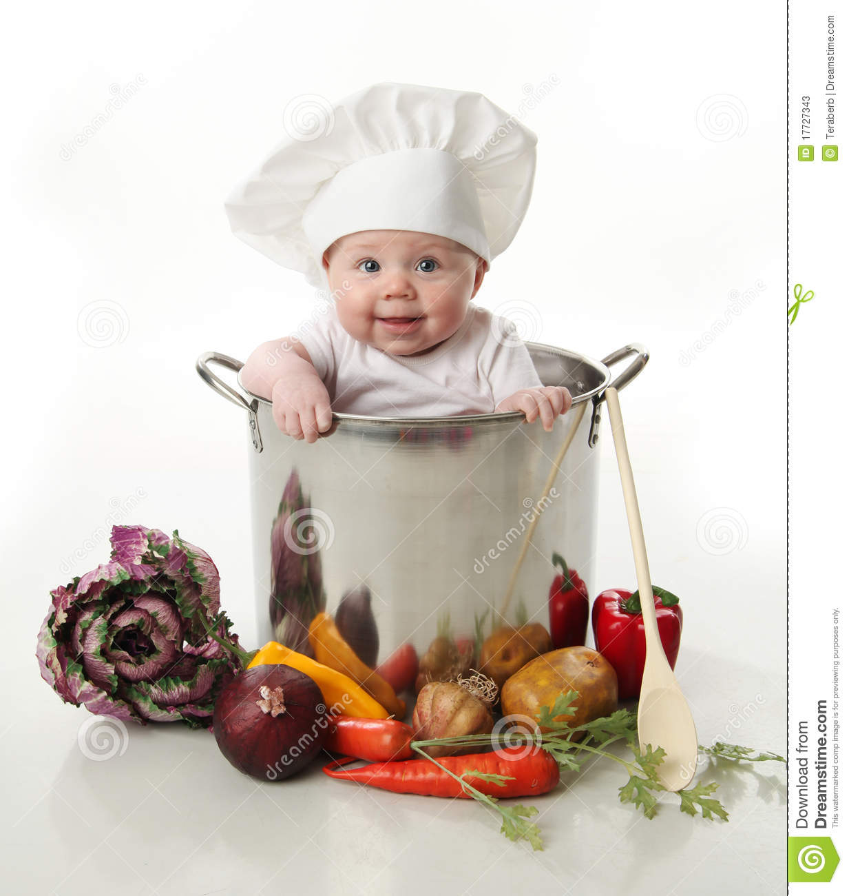 Portrait of a smiling baby sitting inside a large cooking stock pot