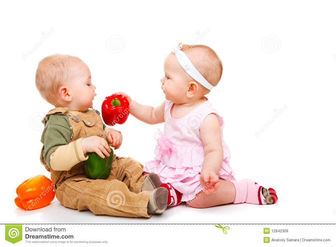 Baby couple eating peppers stock image. Image of holding ...