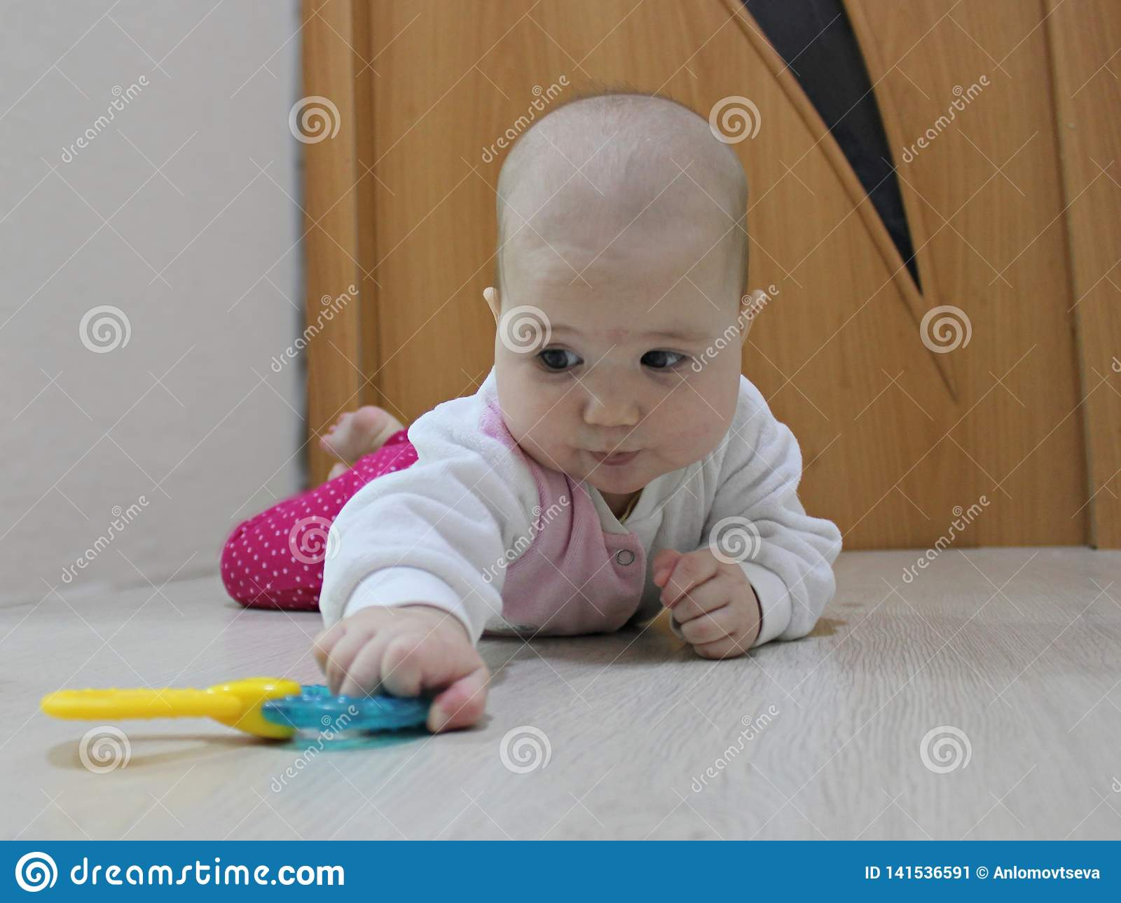 Baby crawling after a toy
