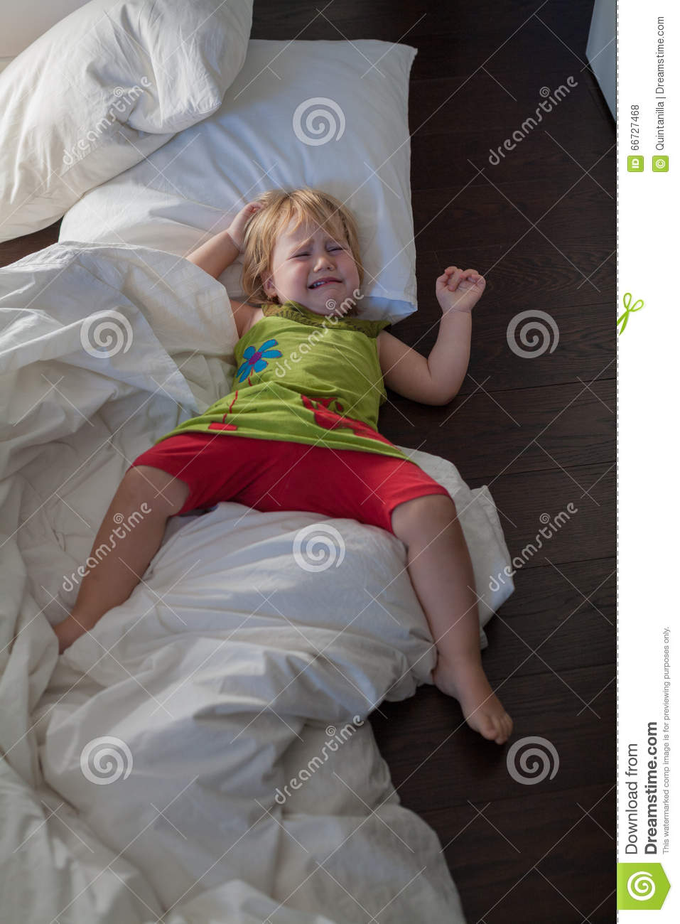 woman crying in bed crying at clothes peg royalty free stock photo 9500