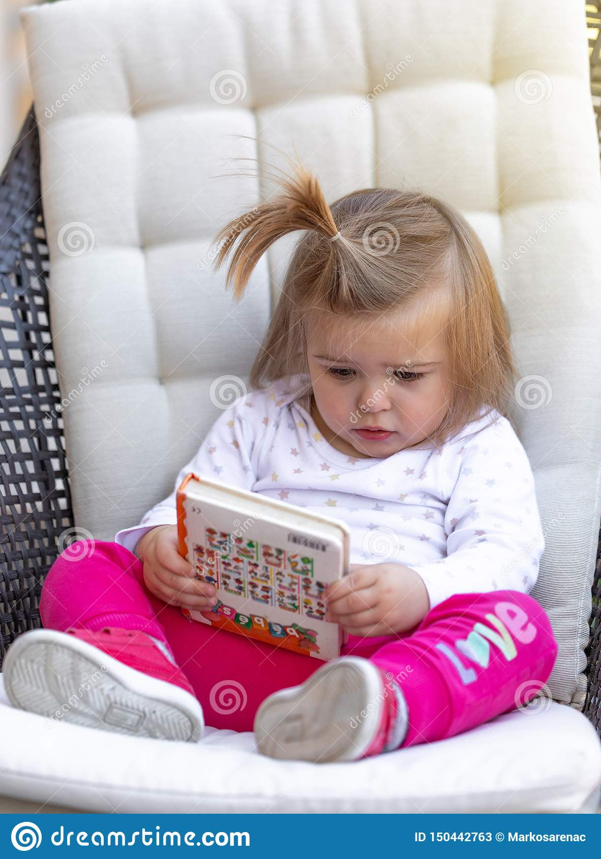 Baby Cute Girl Read Book Child Face Stock Image