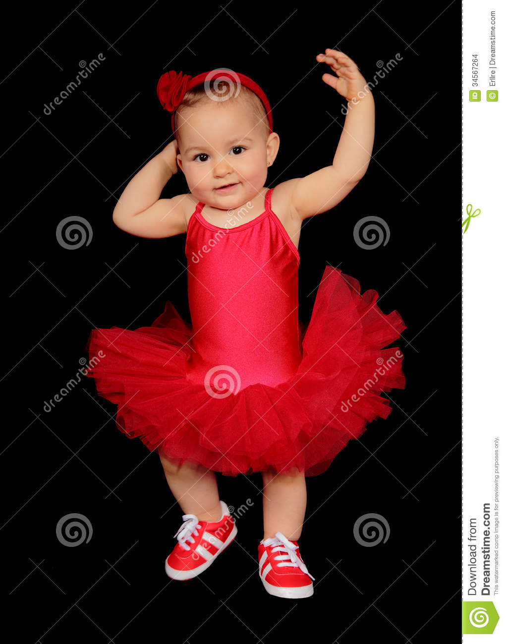 Picture of a pretty baby with a dancer dress on a black background.