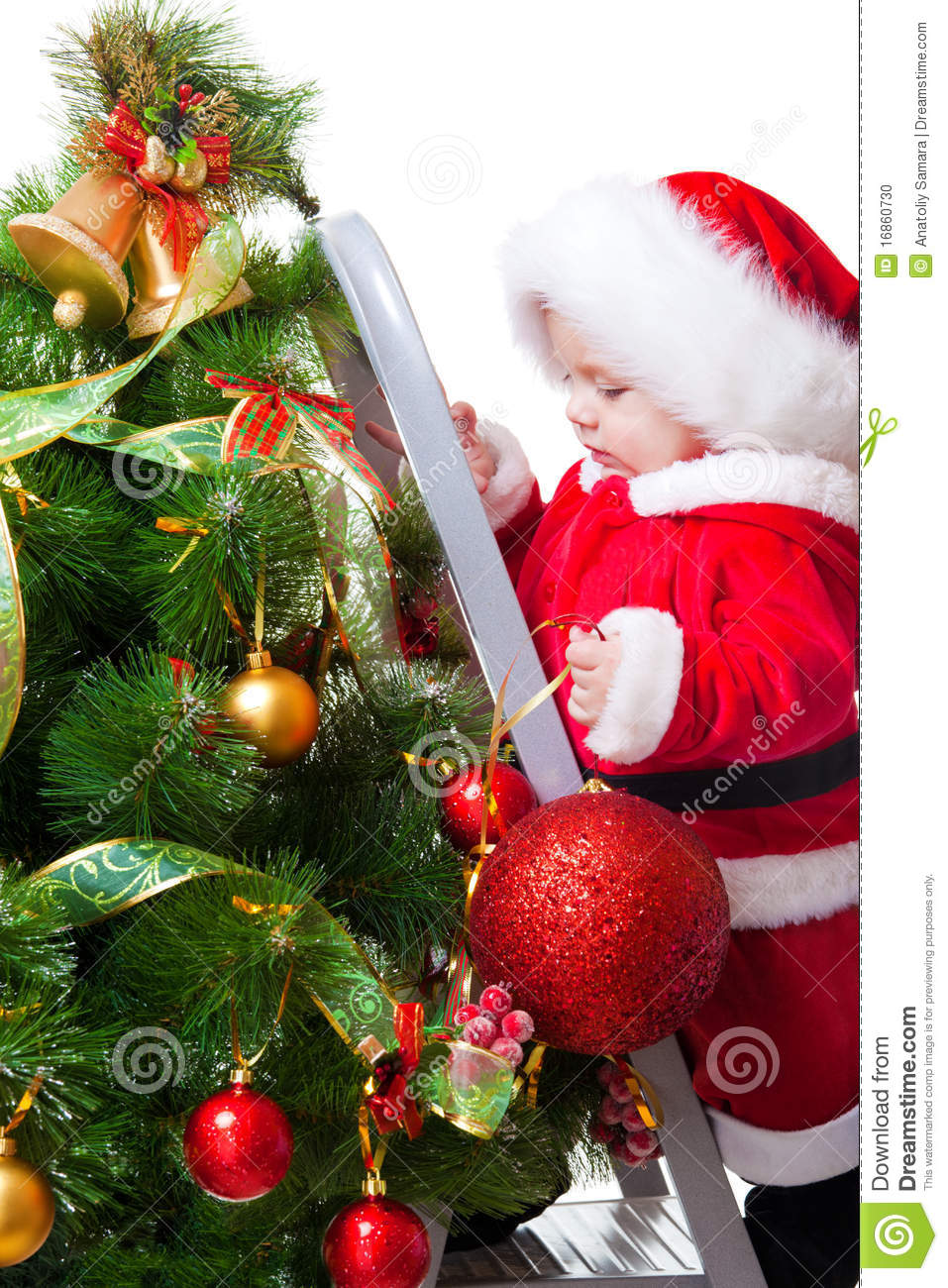 Baby decorating christmas tree stock photo image 16860730 for Baby christmas tree decoration
