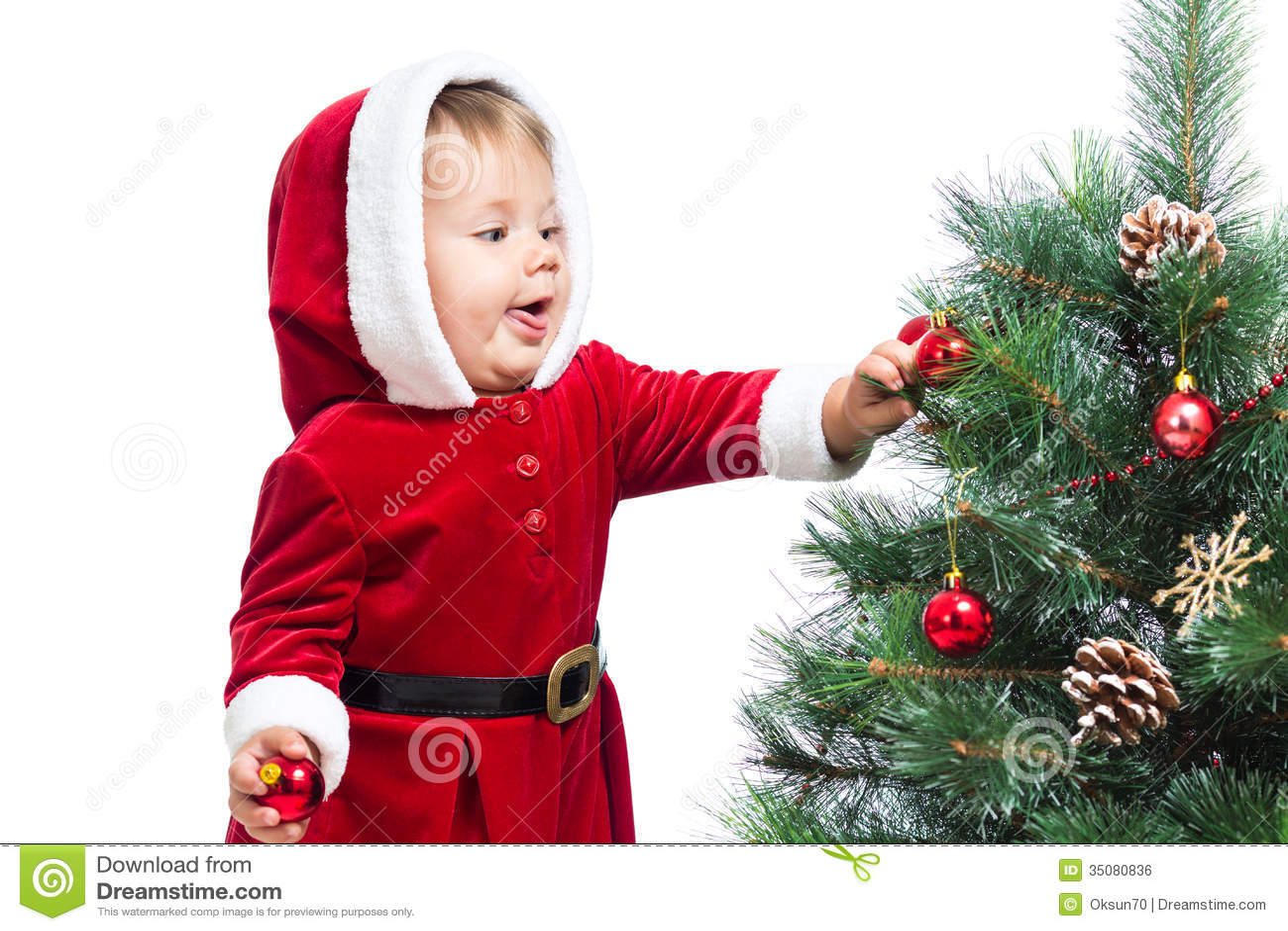 Baby decorating christmas tree stock photo image of for Baby christmas tree decoration