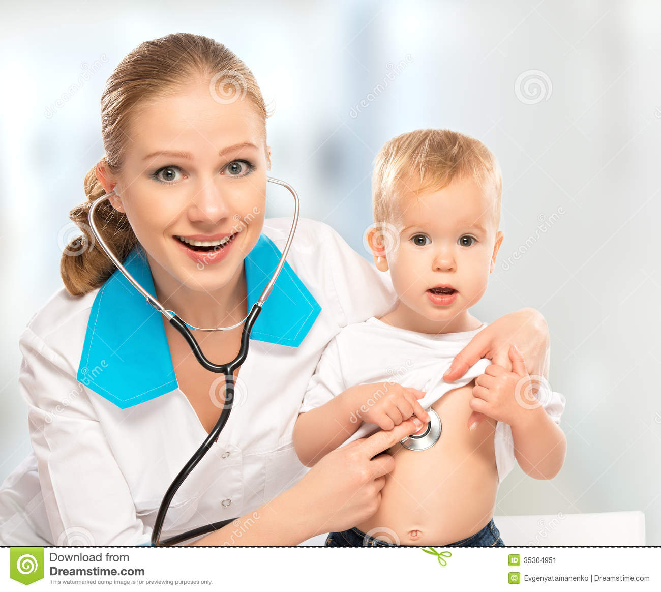 Baby And Doctor Pediatrician. Doctor Listens To The Heart With S Stock ...