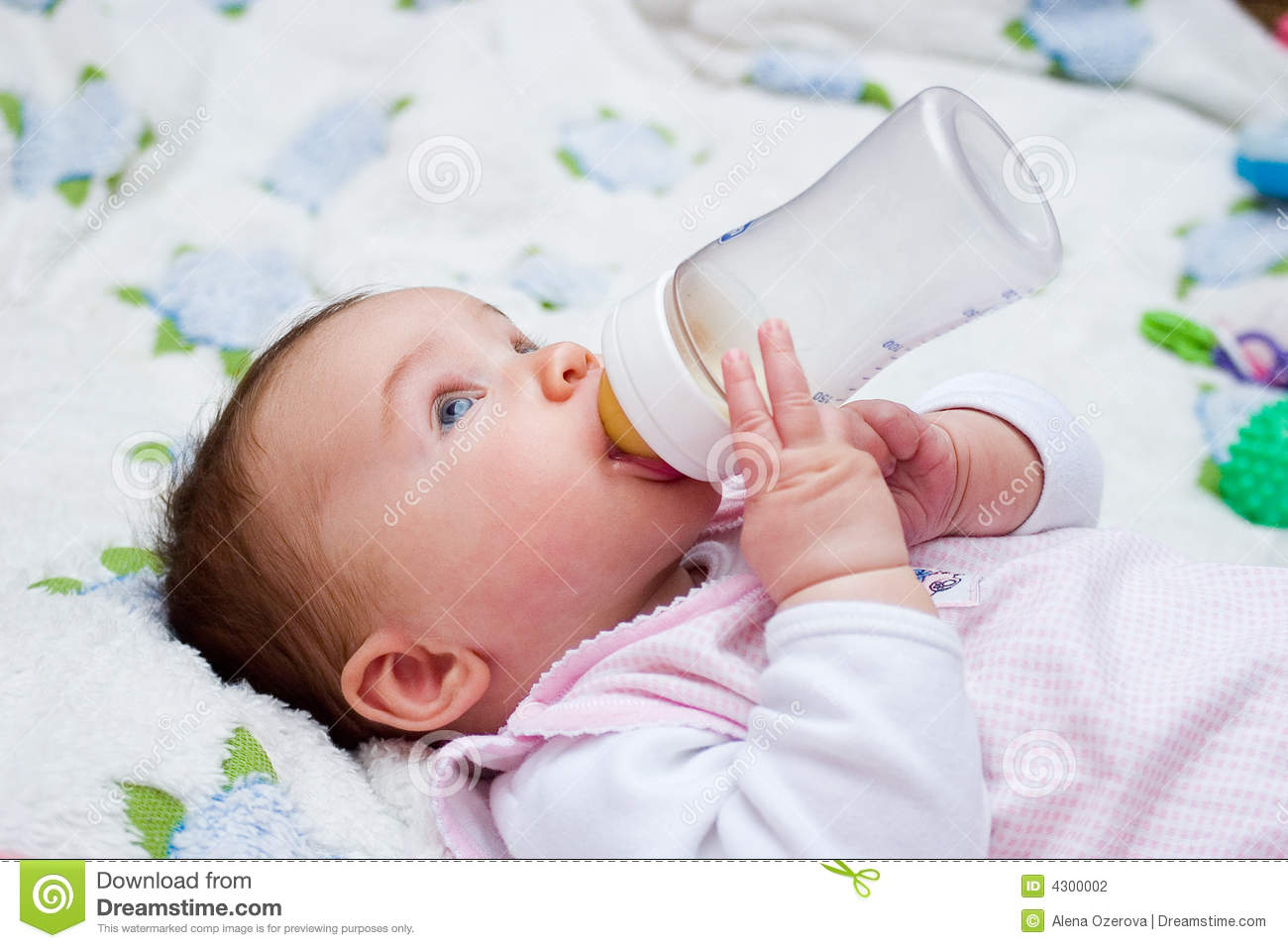 Baby Drinking Milk From Bottle Stock Photo - Image: 4300002
