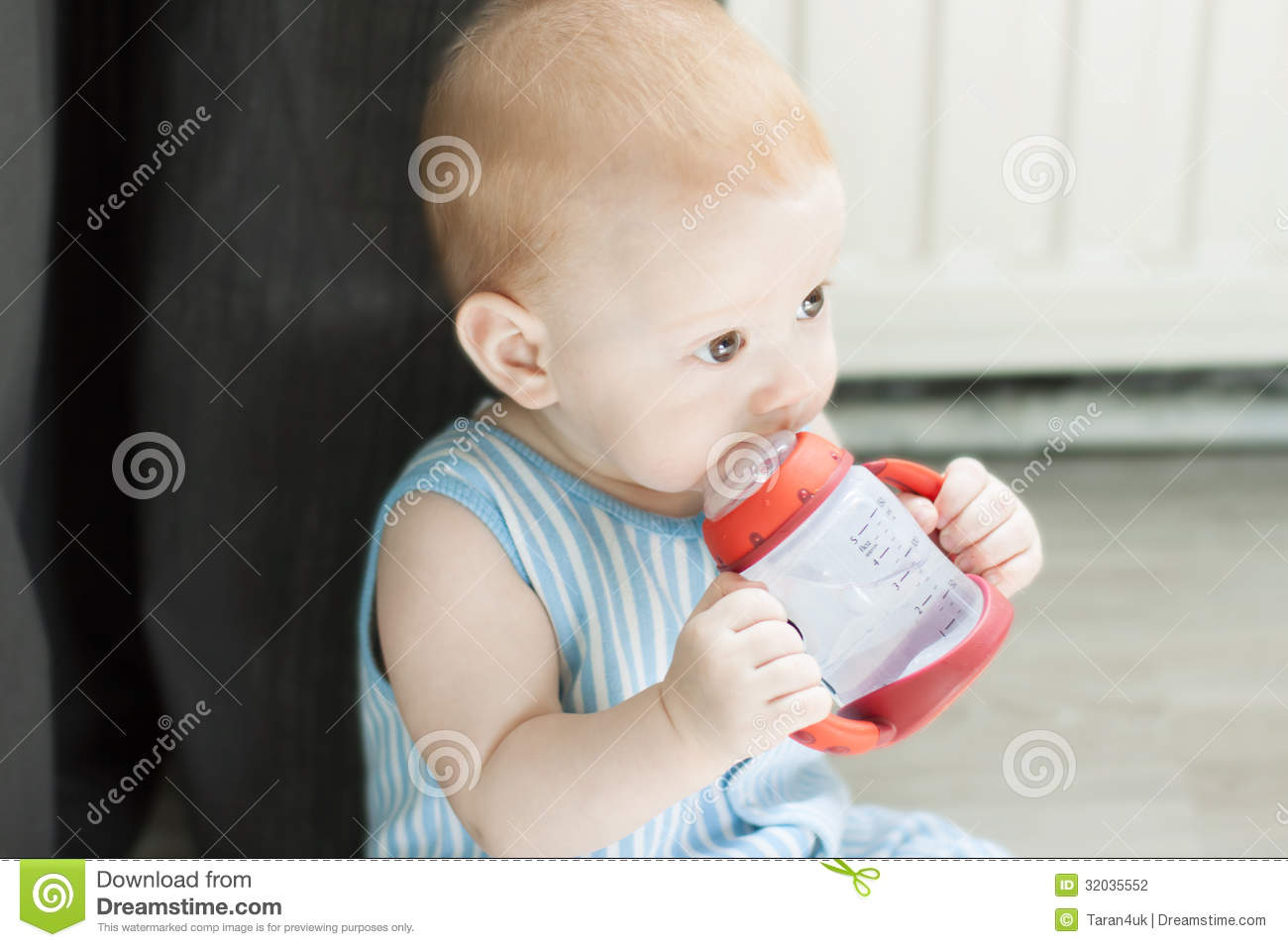 Baby Drinking Water From Bottle Stock Photography Image