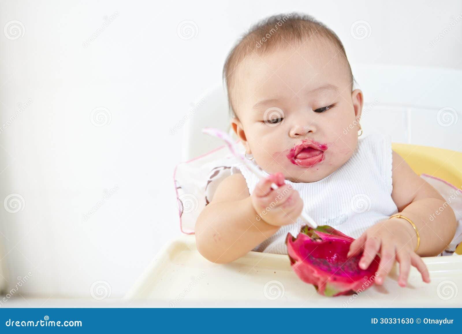 Baby Eating Dragon Fruit