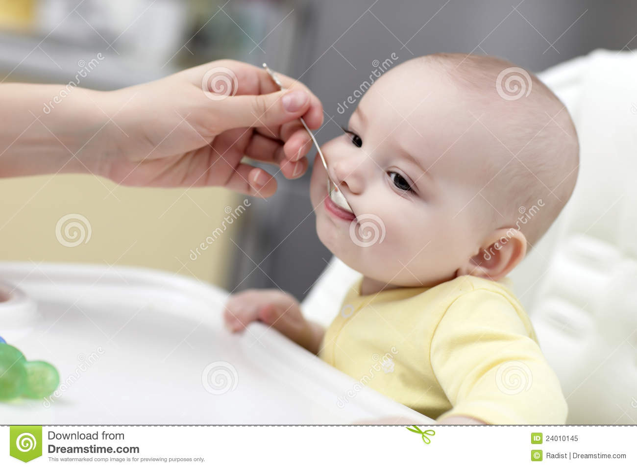 baby eating with spoon royalty free stock photo