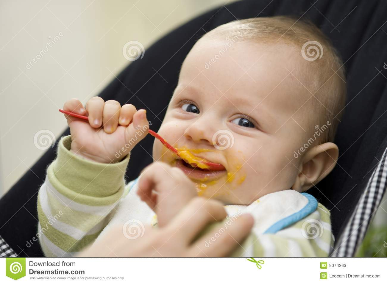 Baby eating with spoon stock photos image 9074363