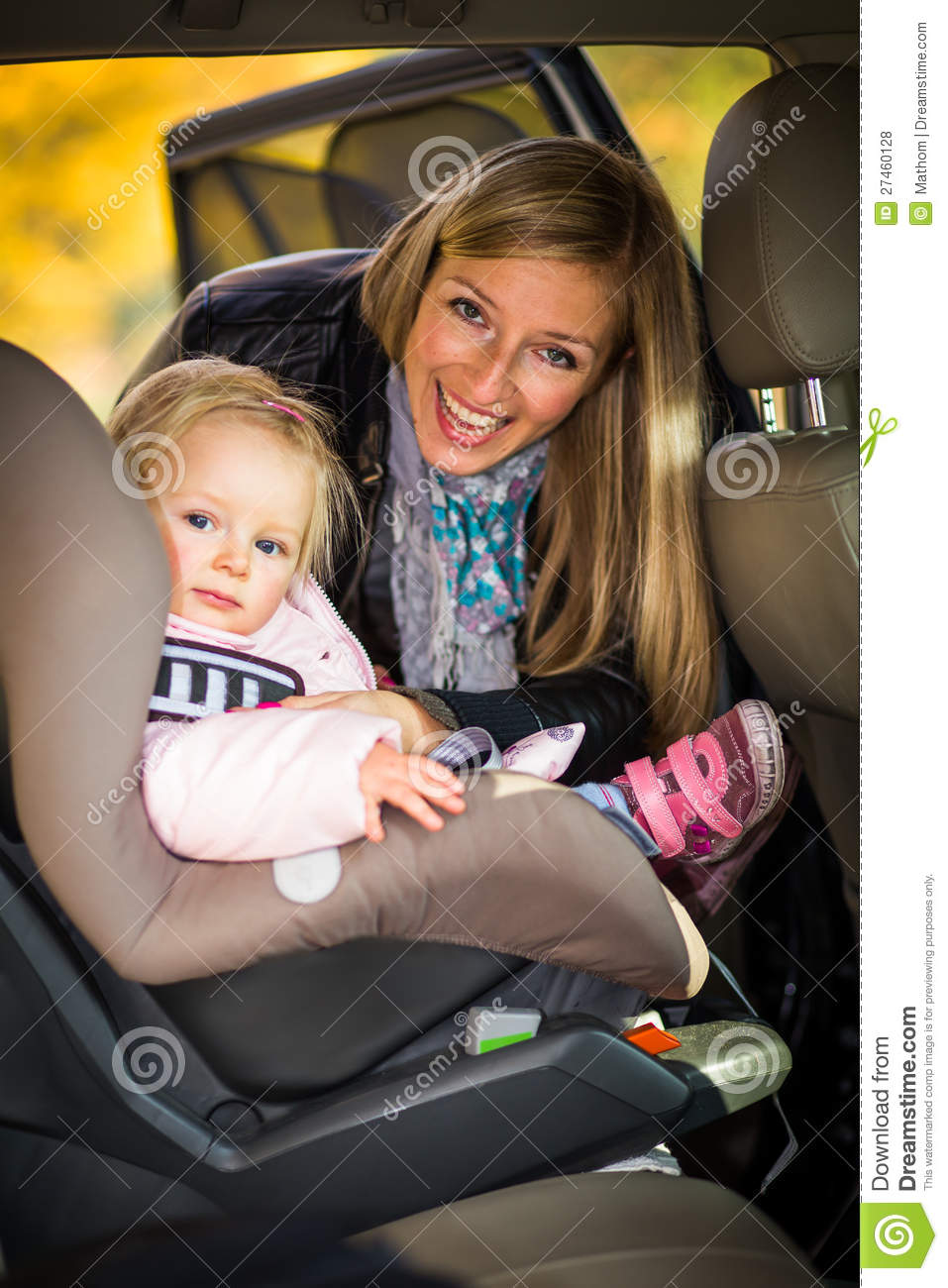 Baby Fastened In Car Seat Royalty Free Stock Photos