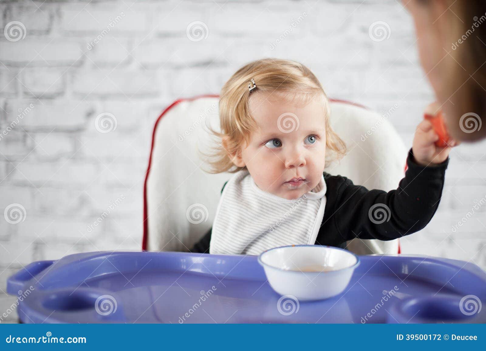 Baby feeding father