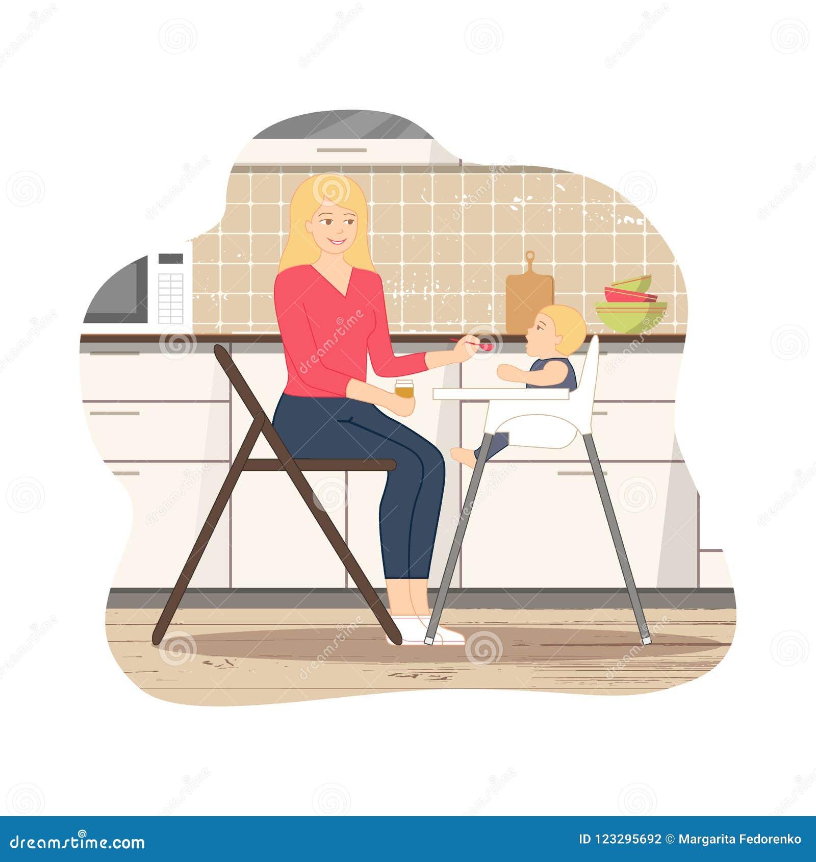 Baby feeding in kitchen