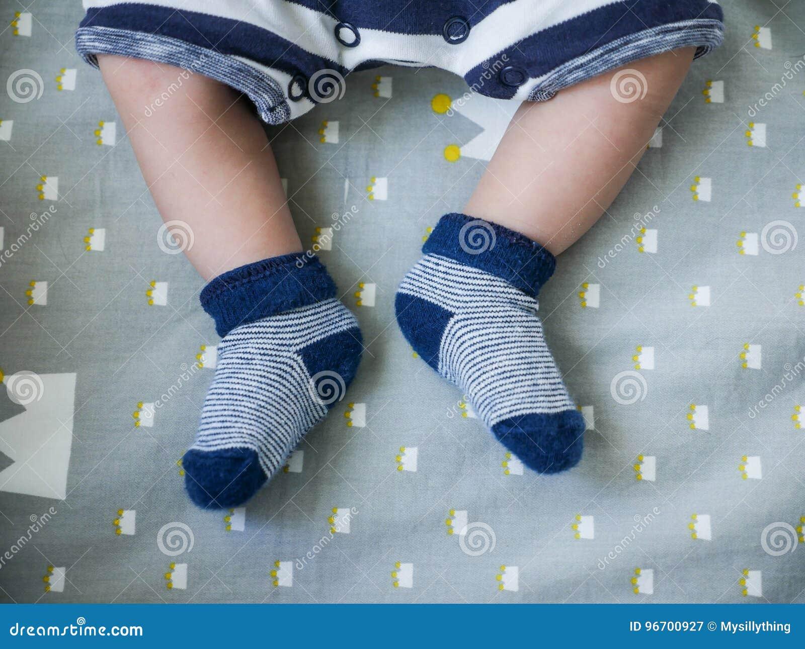 Baby Feets In Blue Socks Keep Baby Feet Warm Stock Image Image