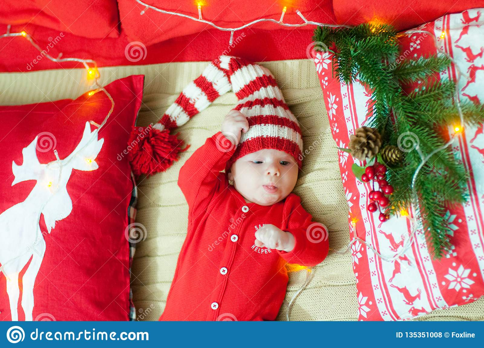 209ab41d0101b Baby first christmas. Beautiful little baby celebrates Christmas. New  Year`s holidays. Baby with santa hat with gift. Santa baby. - Bilder