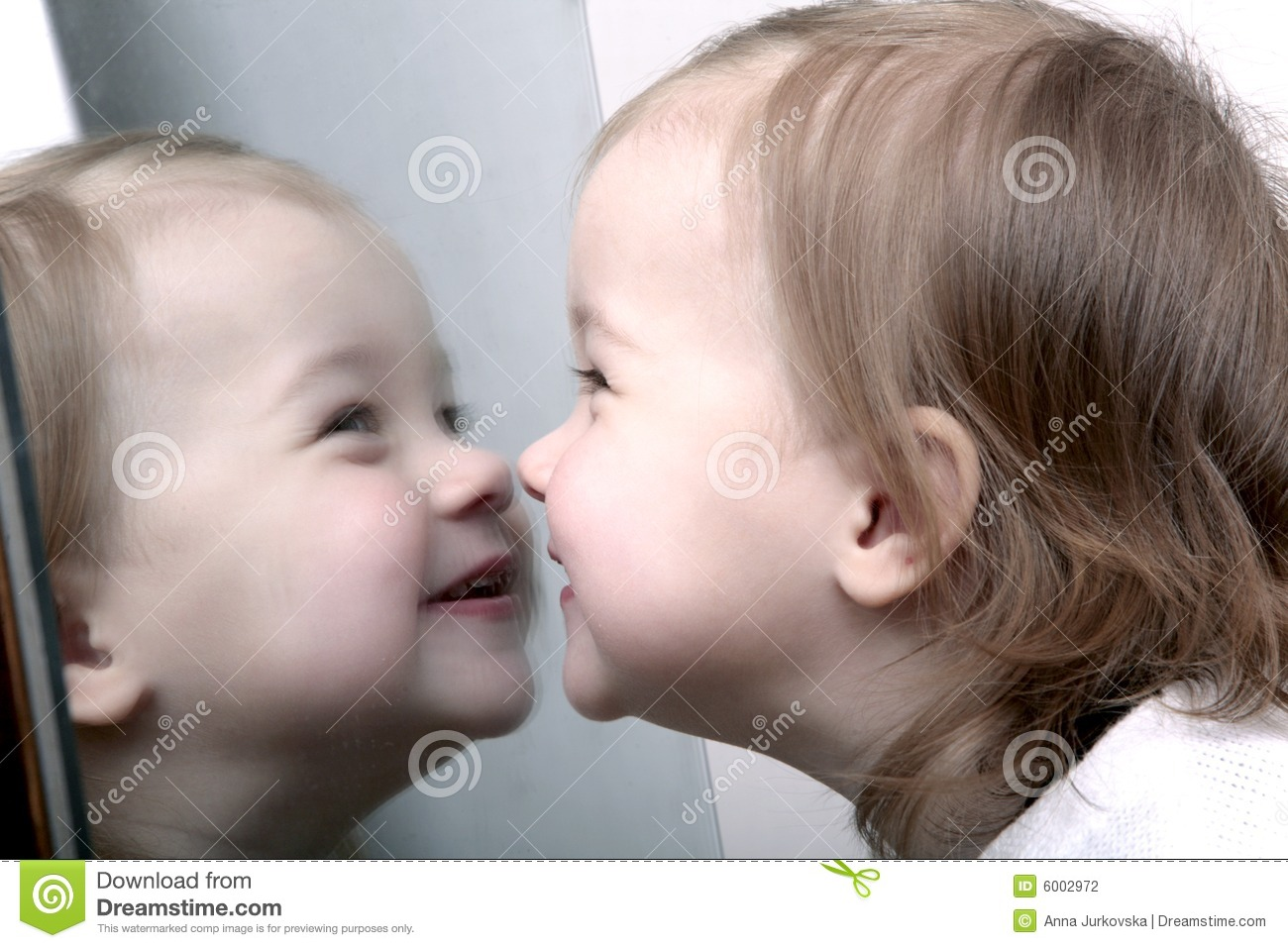 Baby In Front Of Mirror Stock Photography