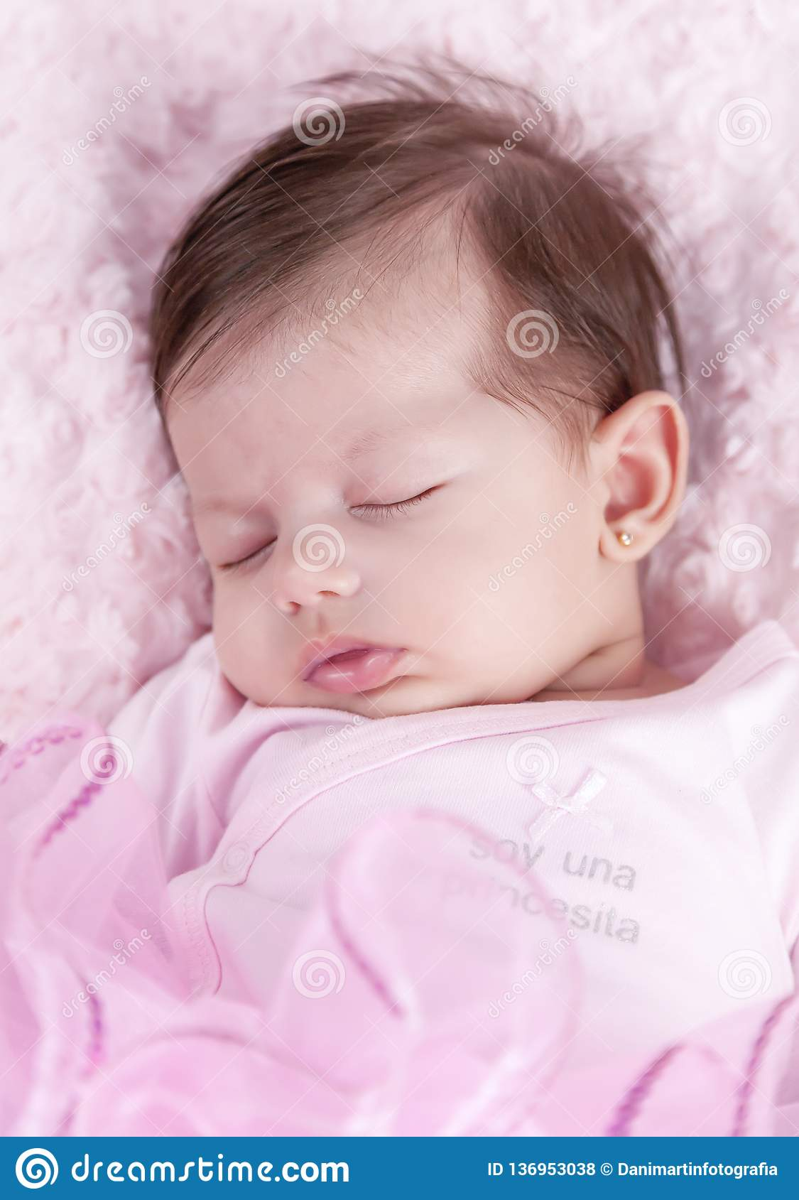 Baby Girl Asleep On Pink Bed. Newborn. Pink Clothes Stock ...