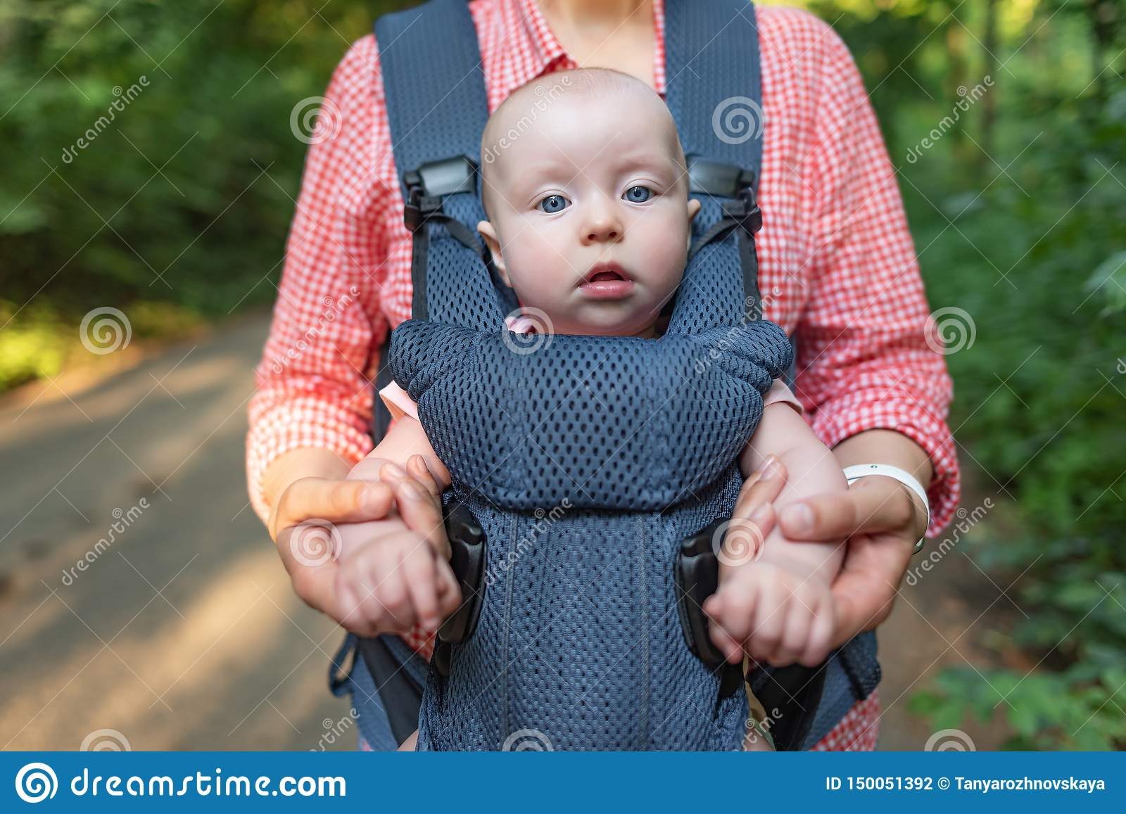 Young Mother And Her Baby Girl In A Baby Carrier  Stock